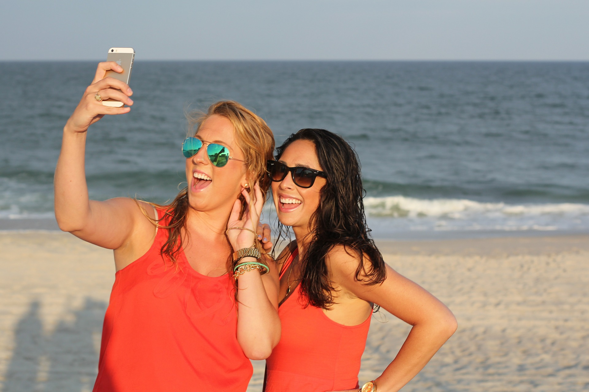 Girls on the beach taking pictures